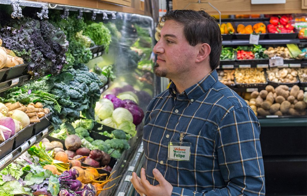Felipe has difficulty shopping produce because he injured his finger.