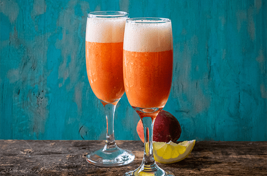Sparkling Peach Lemonade in Tall Glasses